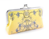 Bright yellow clutch bag with mirrored photomontage tree design and an 8 inch purse frame