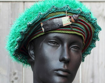 Green-Toned Crochet Hat with a Wikie Pin...