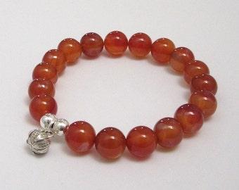 Fertility Bracelet, Red Carnelian Chakra Mala Bracelet, Yoga Inspirational Jewelry, Buddhist Lotus Sterling Silver Charm, July Birthstone