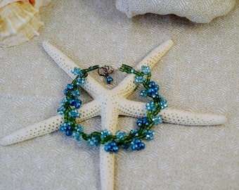 REDUCED Beaded Bracelet: Frosty Cerulean Blue Flowers Growing on a Forest Green Vine - OOAK - Frosted Metallic Pearlized