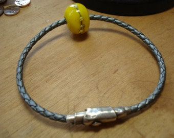 Metallic silver braided leather bracelet with lamp worked bead