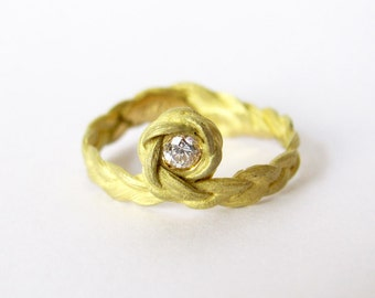Zopf braided ring bow in 18ct yellow gold with diamond