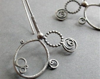asymmetry earrings simple sterling silver long dangle hip funky metalwork metalsmith modern edgy statement jewelry