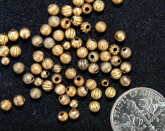 Vintage brass Corrugated Spacer Beads.  3 mm with a .040 inch hole opening. 50 pieces.
