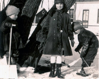 vintage photo Girl and Boys shovel the snow