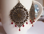 Vintage-style brass filigree with red Swarovski crystal drops