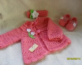 So cute hand crocheted baby girl little cardigan with matching skimmers shoes and headband in a wonderful strawberry color