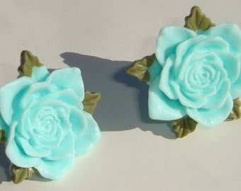 ice blue roses with green leaves hand made clip on earrings