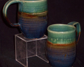 BLUE-GREEN MUG. 5.5 (3.5)W X 4H inches. hi fired glazed wheel thrown stoneware