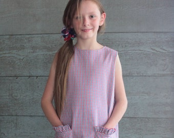 Girl's Dress with Ruffle Pockets and Button Back