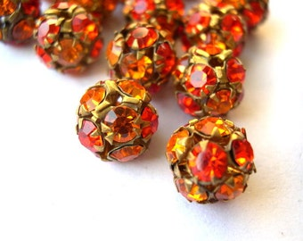 2 Vintage SWAROVSKI BEADS 11mm, orange shades crystals in brass setting creating ball bead