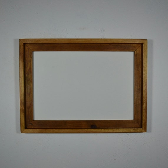 13x19 wood frame hangs either way