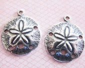 2 Small Silver Sand Dollar Charms 3173