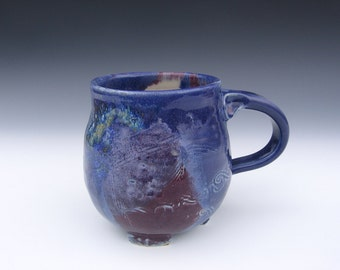 Pottery mug in shades of purple and blue