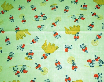 vintage 70s novelty print fabric, featuring cute green circus clowns and elephants design, 1 yard, 31 inches