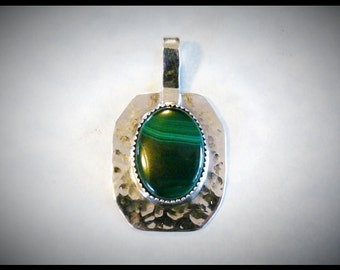 A Nice little Malachite Pendant, one of a kind, handcrafted,hand made. unique.