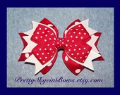A Medium Layered Boutique Hair Bow Clip in Red with Swiss and Polka Dots
