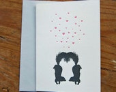 two black skunks in love letterpress valentines day greeting card with pink hearts