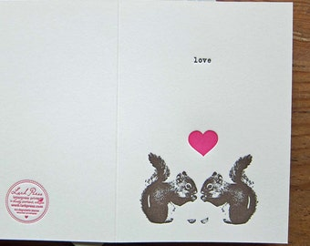 squirrels and love in typewriter valentines day greeting letterpress card with pink heart
