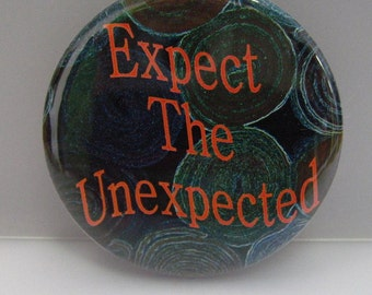 "2 1/4"" pinback button Expect the Unexpected."