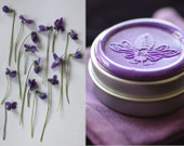 Gracing the Dawn Solid Natural Perfume in Round Tin, abundant with an ethereal bouquet. A delicious exotic floral for Mom with violet notes.