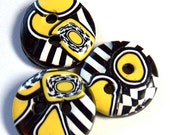 Black, Yellow, and White Graphic Buttons No. 18