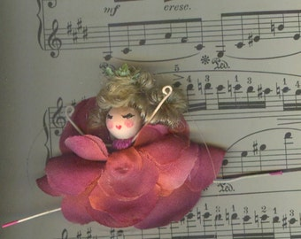 Blonde Flower Fairy with Rose Petals and Curly Hair