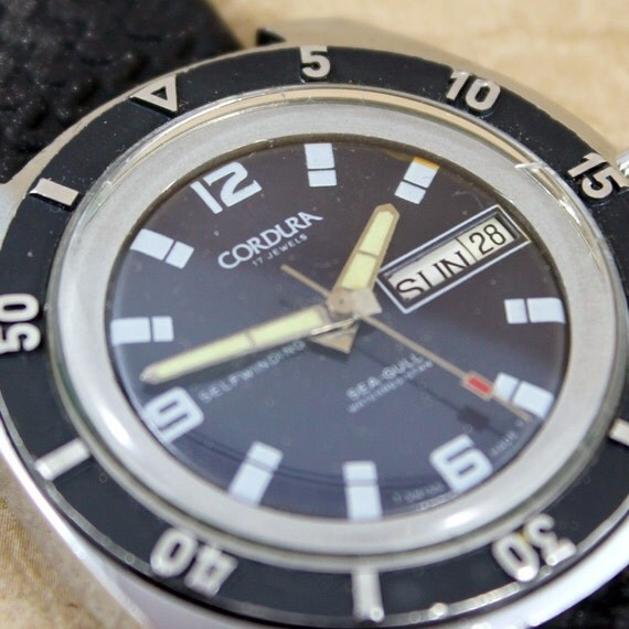 Cordura Sea Gull Watch - Automatic Self Winding Movement - Dive Style - Swiss Made -  Circa 1970's - Silver Tone - Day Date Feature