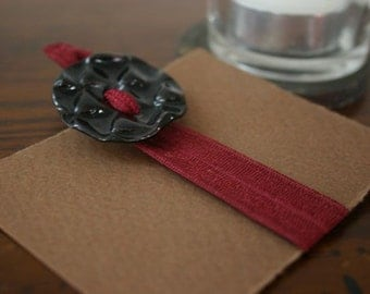 No pull burgundy hair tie with black ceramic accent