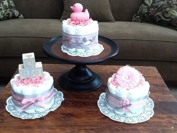 Pink and grey baby shower centerpieces bundt size diaper cakes