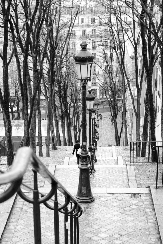 Black and white photography taking the stairs in montmartre