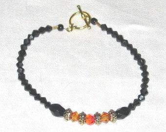 Beautiful Black and Orange Beaded Bracelet - 413