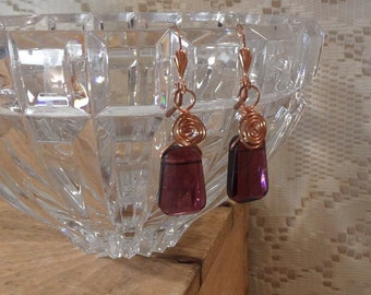 Wire wrapped earrings / amethyst colored glass briolette