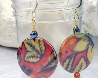 Red shell earrings with golden leaves that dangle, for fall