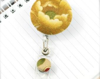 Golden lady - Retractable badge reel