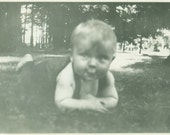 Happy Baby Laying on the Grass Adorable Smile Vintage Black And White Photo Photograph