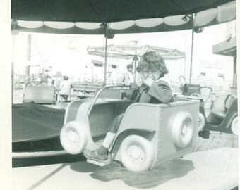 Curly Hair Girl Sitting In A Car Carnival Ride Fair Vintage Photo Black and White Photograph