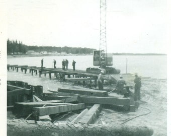 Work Men Building A Dock Pier Crane Timber Construction on Lake 1957 Vintage Black and White Photo Photograph