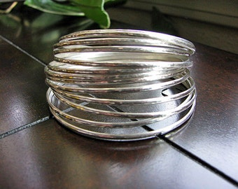 Set of 14 Sterling Silver Bangles