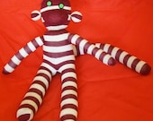Maroon and cream striped Sock Monkey with green eyes