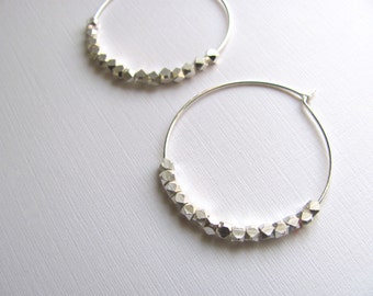 Silver hoop earrings with geometric sterling silver plated beads