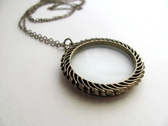 Magnifying glass necklace on long delicate antiqued brass chain