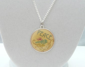 nnm-Round PEACE Charm on a Silver Plated Chain