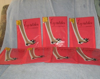 7  packages     Berkshire Eye-Catchers Seamless Nylon  Garter  Stockings sz A      new vintage