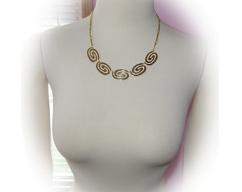 Gold Swirl Necklace with Matching Clip ons  Vintage 1970's