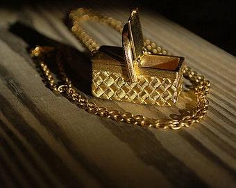 Paquette gold tone picnic basket necklace