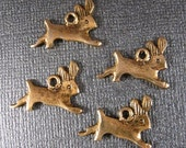 Rabbit Charms 4 Vintage Antiqued Gold Plated Bunny Charms Top Loop 2 Sided Running Rabbits very Cute Cast Charms