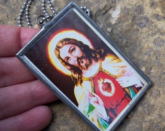 Kitsch Vintage 1980's Large Jesus Pendant on the back of Mexican Carta Blanca Beer Tin