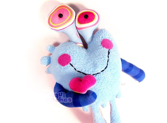 Evan. a cute blue and pink dripping heart character, 'corazon chorreante'. special St Valentine's Day