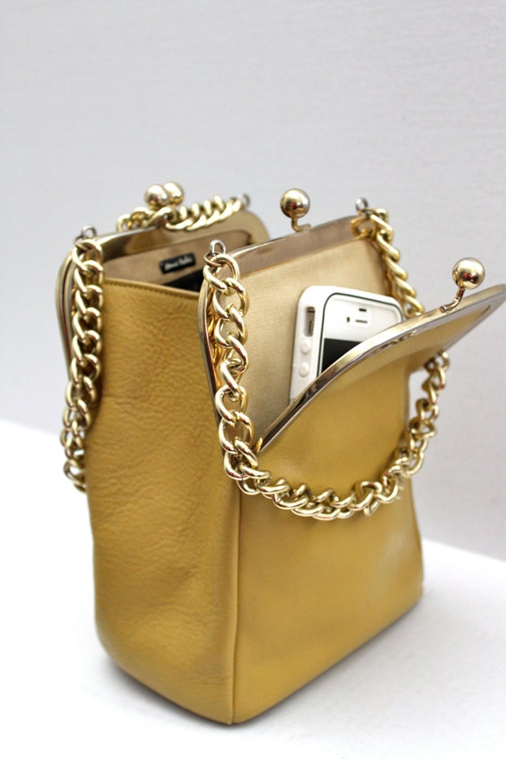 Iconic 60s Bonnie Cashin double kiss lock swing bag // in mustard